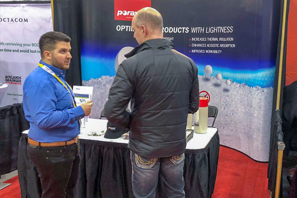 Customer at the Poraver booth at the Canadian Concrete Expo
